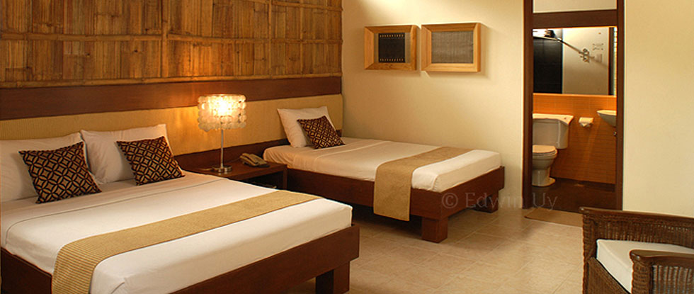 One of the best accommodations in Camiguin, this Cluster Room has a minimalist yet warm interiors. BOYSEN<sup>®</sup> Paint was<br> used in the rafters & beams, BOYSEN<sup>®</sup> wood stain products for bed, side table, headboard and doors.