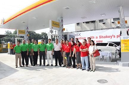 Pilipinas Shell joins fight vs. air pollution by painting one petrol station at a time